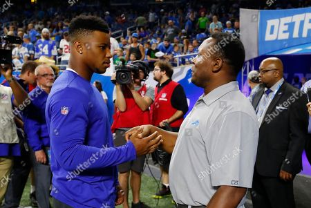 Saquon Barkley, Barry Sanders. New York Giants running back Saquon Barkley, left, meets with former Detroit Lions running back Barry Sanders before a preseason football game, in Detroit