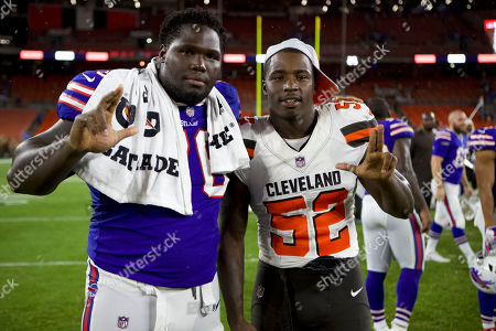 \Buffalo Bills offensive guard John Miller (76) poses with Cleveland Browns linebacker James Burgess (52) after the NFL football game between the Buffalo Bills and the Cleveland Browns at First Energy Stadium in Cleveland, Ohio
