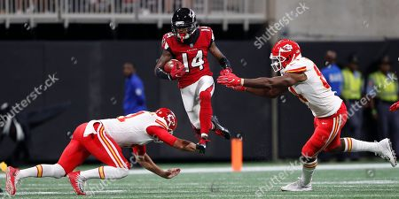 Kansas City Chiefs linebacker Otha Peters, left, and Kansas City Chiefs tight end Demetrius Harris prepare to tackle Atlanta Falcons wide receiver Justin Hardy (14) on a punt return during the first half of an NFL preseason football game, in Atlanta