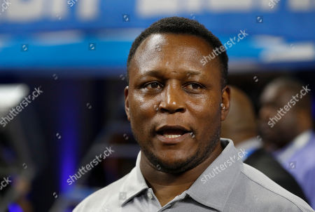 Former Detroit Lions Hall of Fame running back Barry Sanders talks before a preseason NFL football game against the New York Giants in Detroit