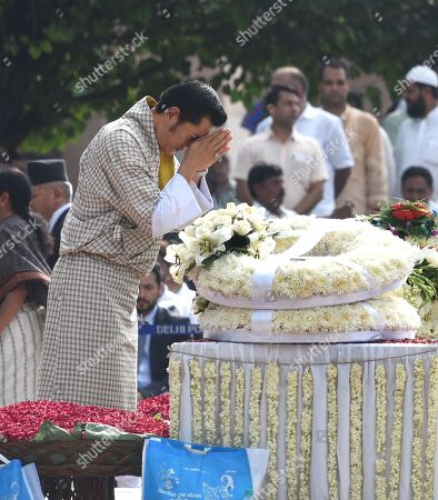 Bhutan King Jigme Khesar Namgyel Wangchuck pays his final respects during the cremation ceremony of former Prime Minister Late Atal Bihari Vajpayee, at Rashtriya Smriti Sthal on August 17, 2018 in New Delhi, India.