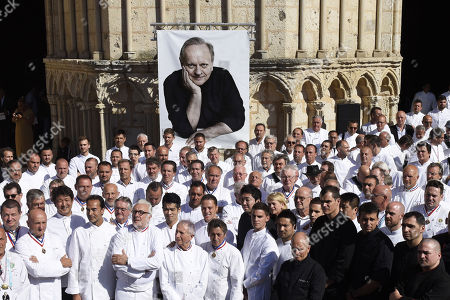 French chefs are seen after a ceremony of tribute to the famous star chef Joel Robuchon at Saint-Pierre Cathedral in Poitiers
