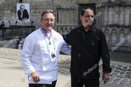 Chef Philippe Gobet and chef Philippe Braun are seen before a ceremony of tribute to the famous star chef Joel Robuchon at Saint-Pierre Cathedral in Poitiers