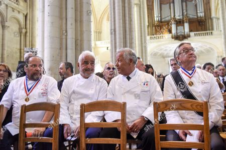 French chefs including Georges Blanc and Guy Savoy are seen during the ceremony of tribute to the famous star chef Joel Robuchon at Saint-Pierre Cathedral in Poitiers