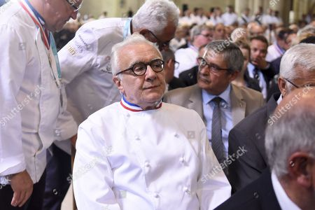 French Chef Alian Ducasse is seen during a ceremony of tribute to the famous star chef Joel Robuchon at Saint-Pierre Cathedral in Poitiers
