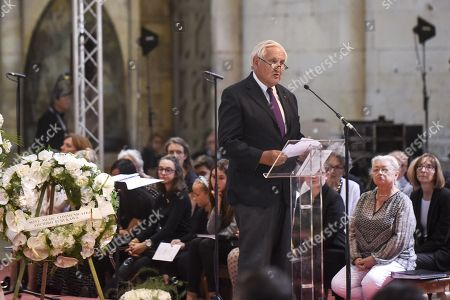 Former Prime Minister Jean-Pierre Raffarin delivers a speech during a ceremony of tribute to the famous star chef Joel Robuchon at Saint-Pierre Cathedral in Poitiers