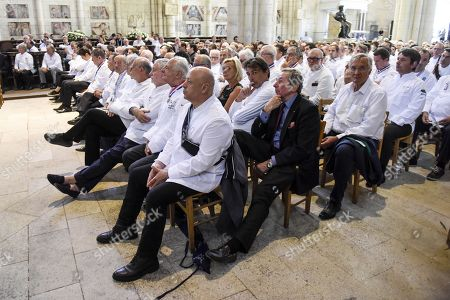 French chefs including Thierry Marx and Yannick Alléno are seen during a ceremony of tribute to the famous star chef Joel Robuchon at Saint-Pierre Cathedral in Poitiers