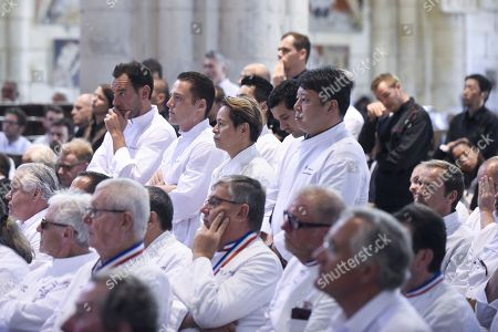 Stock Image of The Team of Chef Joel Robuchon are seen during a ceremony of tribute to the famous star chef Joel Robuchon at Saint-Pierre Cathedral in Poitiers