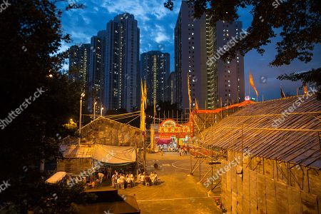 A temporary altar and bamboo theater are set up on a playground in celebrations of the Hungry Ghost Festival in Hong Kong, 17 August 2018 (issued 18 August 2018). According to traditional Chinese belief, the seventh month in the lunar calendar is when restless spirits roam the earth. Many Chinese people make efforts to appease these transient ghosts, particularly on the 15th day, which is the Yu Lan or Hungry Ghost Festival.