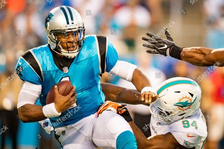 Carolina Panthers quarterback Cam Newton (1) is sacked by Miami Dolphins defensive end Robert Quinn (94) during the preseason NFL football game between the Miami Dolphins and the Carolina Panthers on in Charlotte, NC