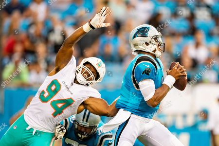 Carolina Panthers quarterback Cam Newton (1) and Miami Dolphins defensive end Robert Quinn (94) during the preseason NFL football game between the Miami Dolphins and the Carolina Panthers on in Charlotte, NC