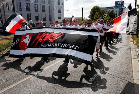 Far-right supporters hold a banner reading 'Murder is not time barred' in a demonstration commemorating the death anniversary Rudolf Hess in Berlin, Germany, 18 August 2018. Hess died on 17 August 1987 after committing suicide in the Spandau Prison, where he served his life sentence. Hess was one of the most prominent Nazi leaders and appointed Deputy Fuehrer by German dictator Adolf Hitler in 1933.