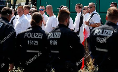 Far-right supporters walk past a line of policemen during a demonstration commemorating the death anniversary Rudolf Hess in Berlin, Germany, 18 August 2018. Hess died on 17 August 1987 after committing suicide in the Spandau Prison, where he served his life sentence. Hess was one of the most prominent Nazi leaders and appointed Deputy Fuehrer by German dictator Adolf Hitler in 1933.