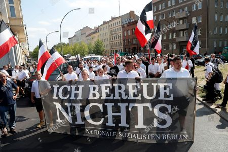 Far-right supporters hold a banner reading 'I regret nothing' in a demonstration commemorating the death anniversary Rudolf Hess in Berlin, Germany, 18 August 2018. Hess died on 17 August 1987 after committing suicide in the Spandau Prison, where he served his life sentence. Hess was one of the most prominent Nazi leaders and appointed Deputy Fuehrer by German dictator Adolf Hitler in 1933.