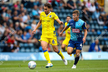 Edward Upson of Bristol Rovers goes past Dominic Gape of Wycombe Wanderers