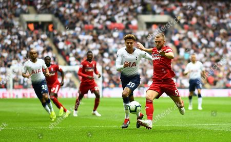 Calum Chambers of Fulham clears under pressure from Dele Alli of Tottenham Hotspur
