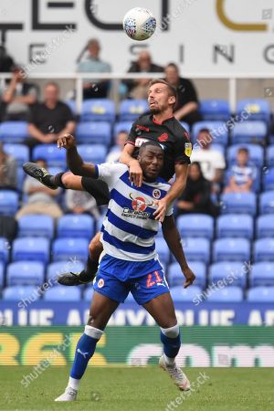 Bolton Wanderers midfielder Gary O'Neil (19) beats Reading midfielder Yakou Meite (21) to a header 0-1 during the EFL Sky Bet Championship match between Reading and Bolton Wanderers at the Madejski Stadium, Reading