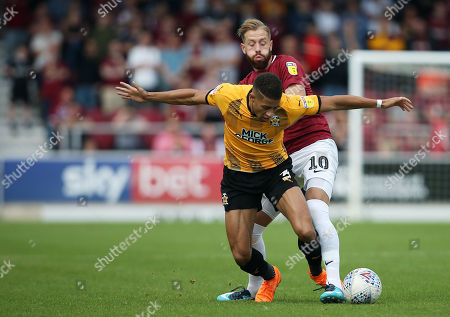 Kevin van Veen of Northampton Town and Jake Carroll of Cambridge United