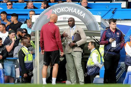 Ex Arsenal player, Sol Campbell, chats with Steve Bould pre-match during Chelsea vs Arsenal, Premier League Football at Stamford Bridge on 18th August 2018