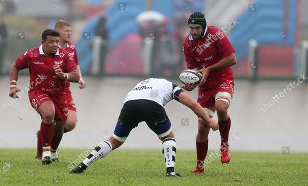 Tom Price of Scarlets is tackled by Jordan Crane of Bristol Bears.