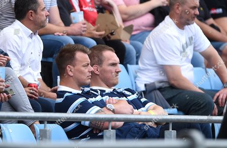 Stock Photo of Matthew Rees and Gethin Jenkins of Cardiff Blues look on.