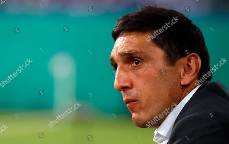 Stuttgart´s head coach Tayfun Korkut looks on during the German DFB Cup first round soccer match between F.C. Hansa Rostock and VfB Stuttgart in Rostock, Germany, 18 August 2018. 
