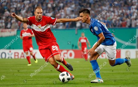 Nico Rieble (L) of Rostock and Stuttgart´s Holger Badstuber in action during the German DFB Cup first round soccer match between F.C. Hansa Rostock and VfB Stuttgart in Rostock, Germany, 18 August 2018.  (ATTENTION: The DFB prohibits the utilisation and publication of sequential pictures on the internet and other online media during the match (including half-time). ATTENTION: BLOCKING PERIOD! The DFB permits the further utilisation and publication of the pictures for mobile services (especially MMS) and for DVB-H and DMB only after the end of the match.)