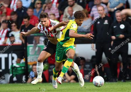 Jamal Lewis of Norwich City with Ryan Leonard of Sheffield United