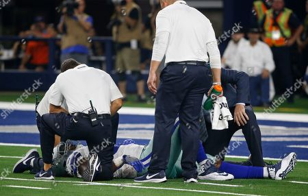 Dallas Cowboys defensive end Datone Jones (56) lies on the field after an injury during the second half of a preseason NFL football game in Arlington, Texas