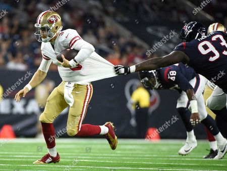Houston Texans defensive end Joel Heath (93) grabs the jersey of San Francisco 49ers quarterback C.J. Beathard (3) during the second half of an NFL preseason football game, in Houston