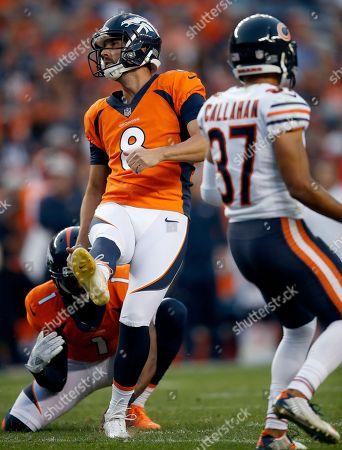 Denver Broncos kicker Brandon McManus (8) kicks a field goal as punter Marquette King (1) holds during the first half of a preseason NFL football game as Chicago Bears cornerback Bryce Callahan (37) looks, in Denver