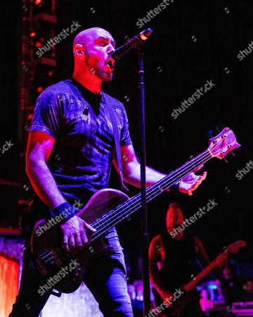 The American alternative rock band Breaking Benjamin with bass player Aaron Bruch performs at the Xfinity Center, in Mansfield, Mass