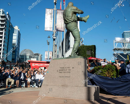 Trevor Hoffman and his family watch his statue being unveiled before a baseball game against the Arizona Diamondbacks in San Diego