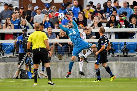 Toronto FC goalkeeper Alex Bono (25) makes a big leap to take control of the ball during the MLS match between Toronto FC and the San Jose Earthquakes at Avaya Stadium in San Jose, California