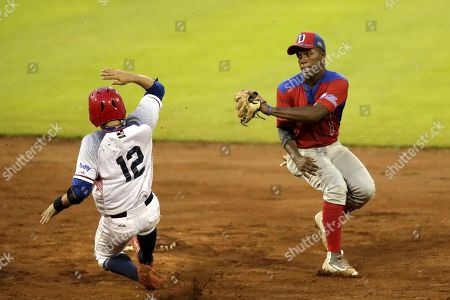 Edwin Hidalgo Osorio (L) of Panama in action against Adael Amador Santiago (R) of Dominican Republic during the Baseball Under-15 World Championships match between Dominican Republic and Panama at the Kenny Serracin stadium in David, Panama, 18 August 2018.