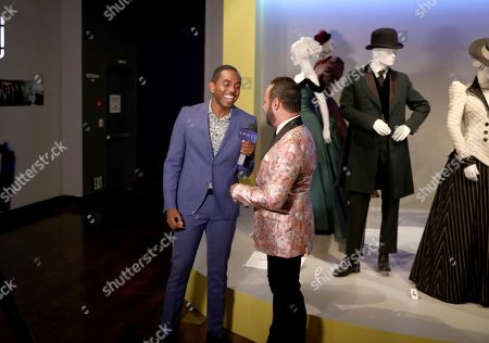 """Nick Verreos, FIDM Alum and Spokesperson, right, participates in an interview at the 12th annual """"Art of Television Costume Design"""" opening at the FIDM Museum & Galleries on the Park, in Los Angeles"""