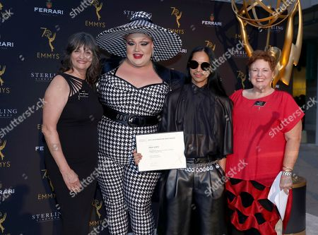 """Terry Ann Gordon, Eureka O'Hara, Zaldy Goco, Sue Bub. Terry Ann Gordon, left, and Sue Bub, right, Television Academy Costume Design and Supervision Governors, pose with Zaldy Goco, second from right, Emmy-nominated costume designer for """"RuPaul's Drag Race,"""" and Eureka O'Hara at the 12th annual """"Art of Television Costume Design"""" opening at the FIDM Museum & Galleries on the Park, in Los Angeles"""