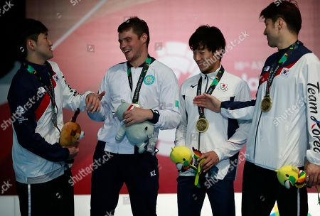 From left to right, silver medalist, Park Sang-young of South Korea, gold medalist Dmitriy Alexanin of Kazakhstan, and bronze medalists Koki Kano of Japan and Jung Jin-sun of South Korea share a light moment during the victory ceremony for men's individual epee fencing at the 18th Asian Games in Jakarta, Indonesia