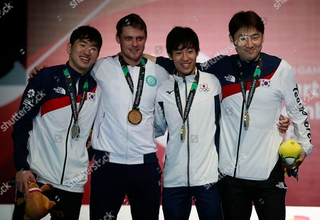 From left to right, silver medalist, Park Sang-young of South Korea, gold medalist Dmitriy Alexanin of Kazakhstan, and bronze medalists Koki Kano of Japan and Jung Jin-sun of South Korea pose for photographers during the victory ceremony for men's individual epee fencing at the 18th Asian Games in Jakarta, Indonesia