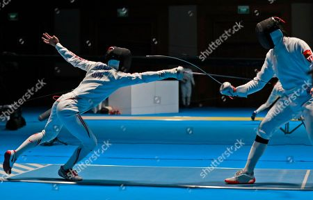 Japan's Koki Kano, left, competes against Vietnam's Nguyen Tien Nath during their men's individual epee fencing match at the 18th Asian Games in Jakarta, Indonesia