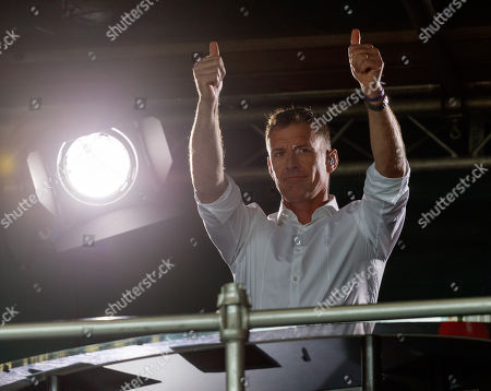 """Chris Sutton BT Sport pundit & former Celtic player smiles as Rangers fans sing, """"Chris Sutton's a W@nker"""" to him during the 2nd half."""