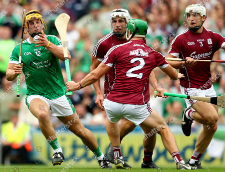 Galway vs Limerick. Limericks' Tom Morrissey goes past Gearoid McInerney, Adrian Tuohey and Daithi Burke of Galway to score his sides second goal