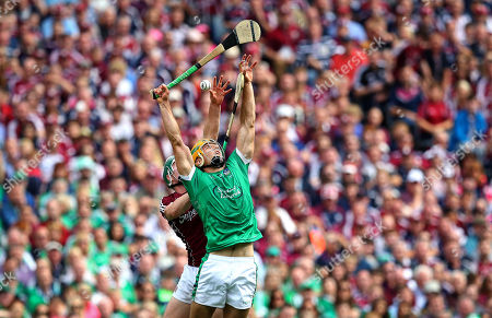 Galway vs Limerick. Galway's Cathal Mannion and Dan Morrissey of Limerick