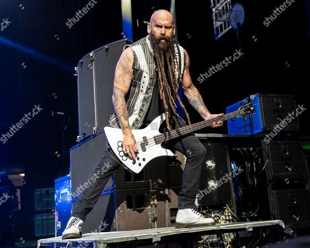 The Las Vegas based American heavy metal band Five Finger Death Punch with bass player Chris Kael performs during at the Xfinity Center, in Mansfield, Mass