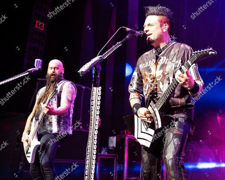 Chris Kael, Jason Hook. The Las Vegas based American heavy metal band Five Finger Death Punch with bass player Chris Kael and lead guitarist Jason Hook performs during at the Xfinity Center, in Mansfield, Mass