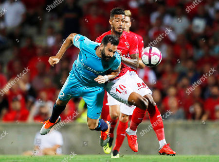 Adil Rami (L) of Marseille in action against Denis Bouanga (R) of Nimes during the French Ligue 1 soccer match between Nimes Olympique and Olympique Marseille in Nimes, southern France, 19 August 2018.