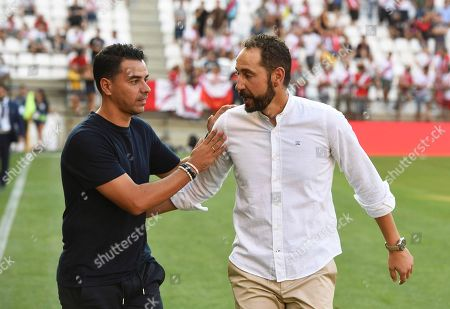 Rayo Vallecano's head coach Miguel Angel Sanchez (L) greets Sevilla's head coach Pablo Machin (R) before the Spanish Primera Division soccer match between Rayo Vallecano and Sevilla FC at the Vallecas stadium in Madrid, Spain, 19 August 2018.