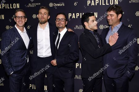 """Joey McFarland, Charlie Hunnam, Michael Noer, Rami Malek, David Koplin. Joey McFarland, from left, Charlie Hunnam, Michael Noer, Rami Malek and David Koplin attend a special screening of """"Papillon"""" at the London Hotel, in West Hollywood, Calif"""