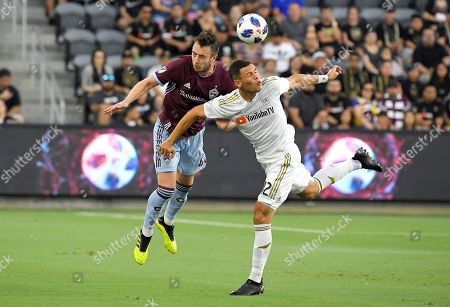 Danny Wilson, Christian Ramirez. Colorado Rapids defender Danny Wilson, left, and Los Angeles FC forward Christian Ramirez try to head the ball during the first half of a Major League Soccer match, in Los Angeles