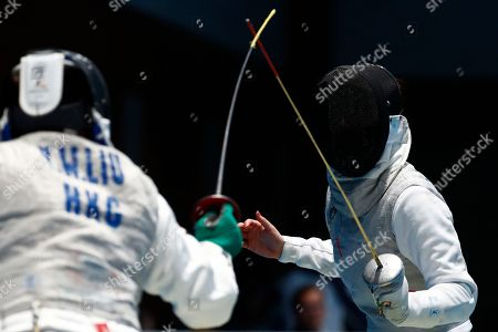 Liu Yan Wai of Hong Kong (L) competes against Huo Xingxin of China (R) in the Women's Foil Individual Quarterfinals during the Asian Games 2018 in Jakarta, Indonesia, 20 August 2018. The 18th Asian Games Jakarta-Palembang 2018 will take place from 18 August until 02 September 2018 in Jakarta and Palembang.